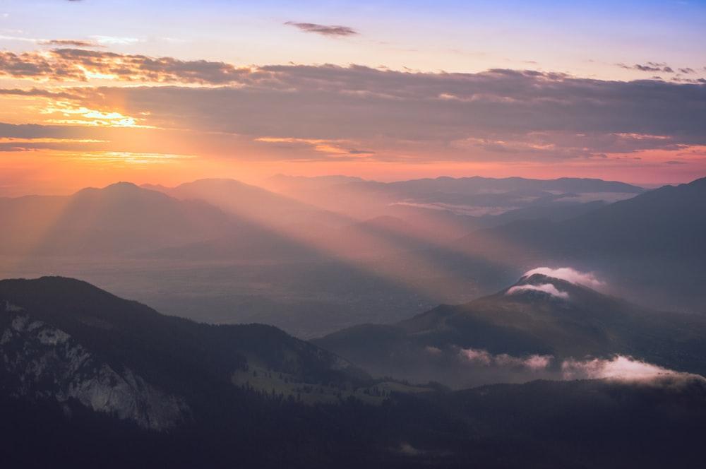 sun rays on mountain illustration