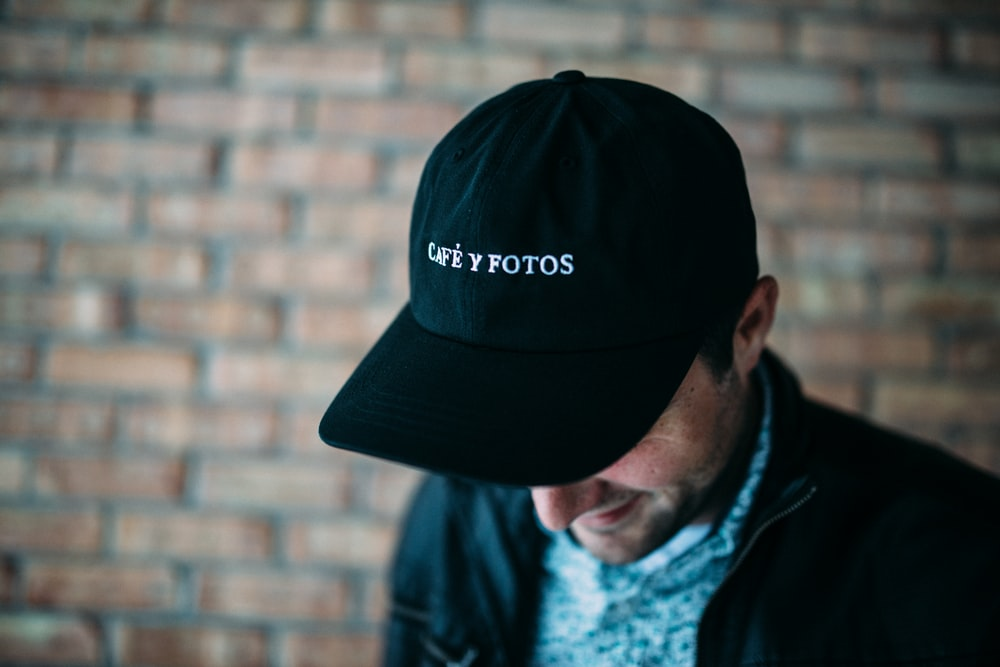 close-up photography of black fitted cap