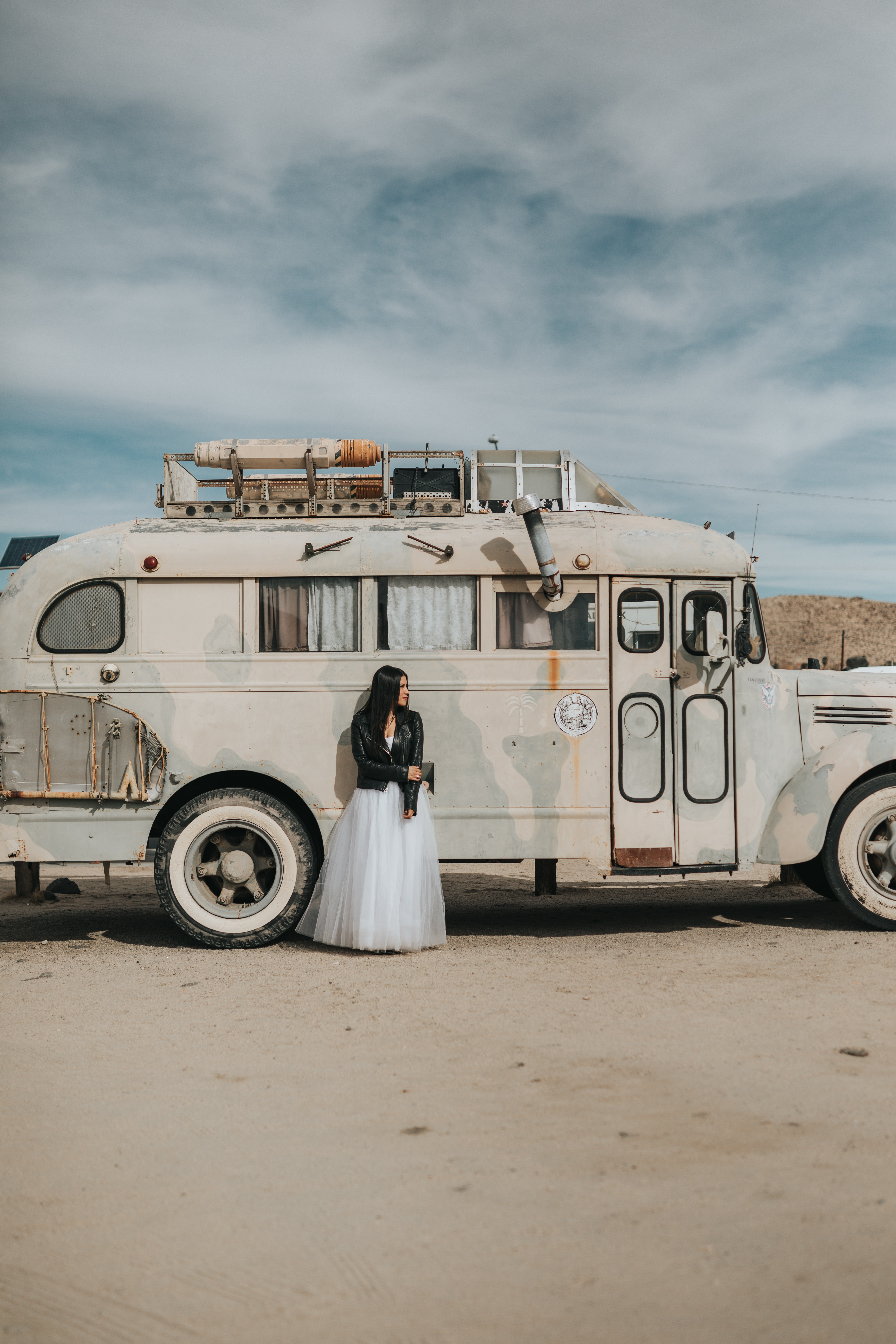 woman standing next to white RV