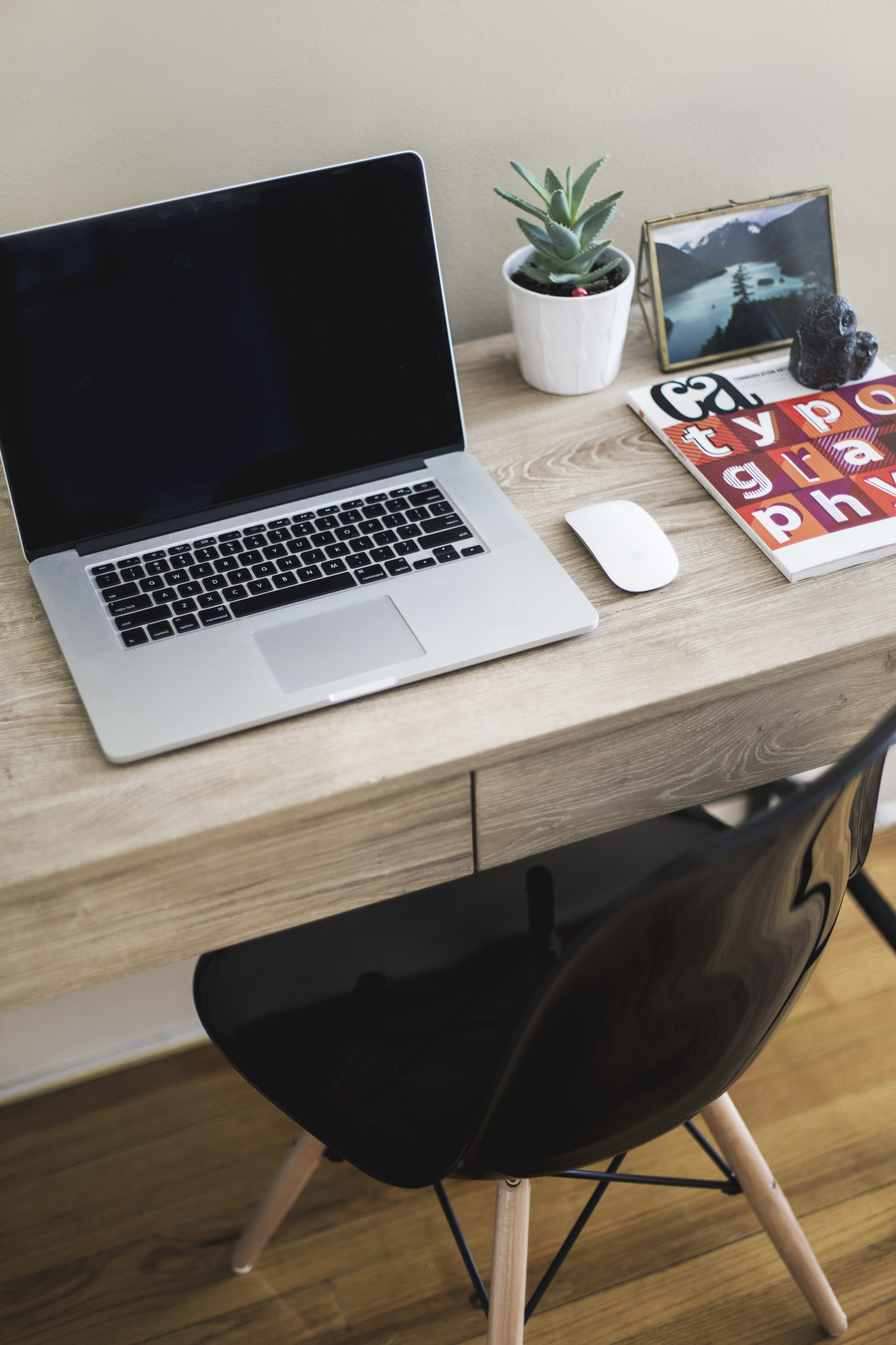 MacBook Pro on table with Magic Mouse