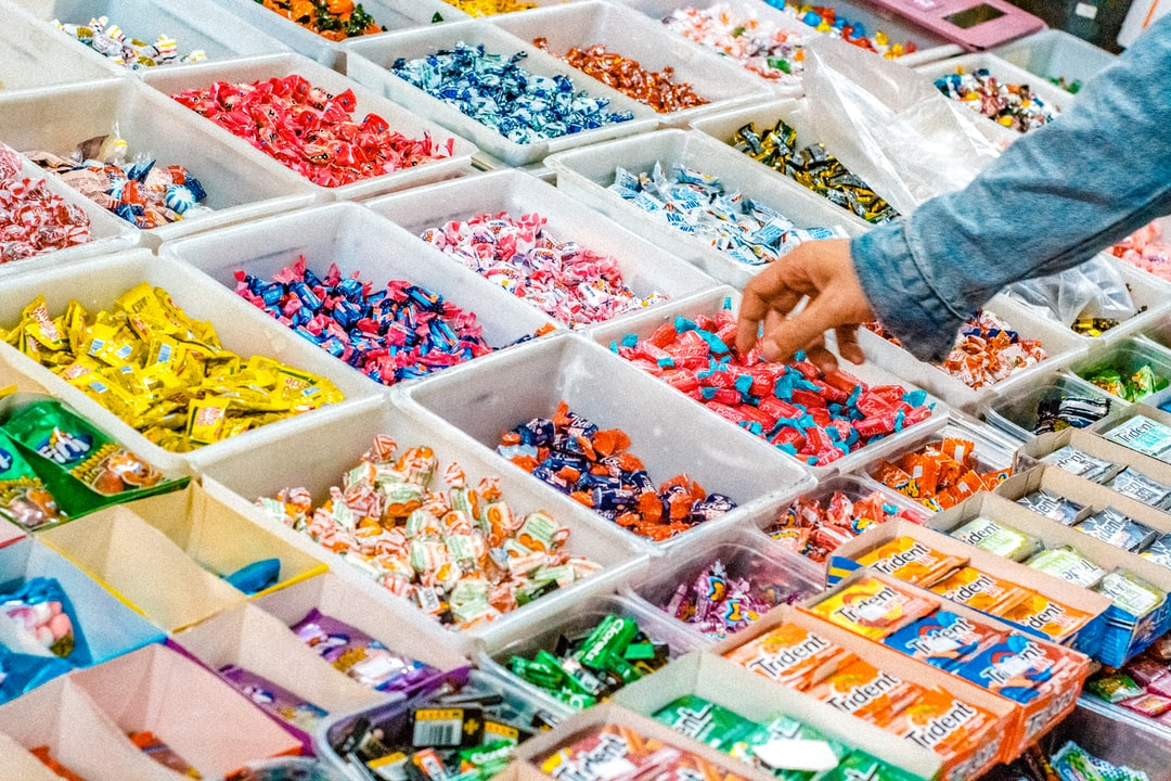 person holding a candy pack is like searching for digital marketing experts