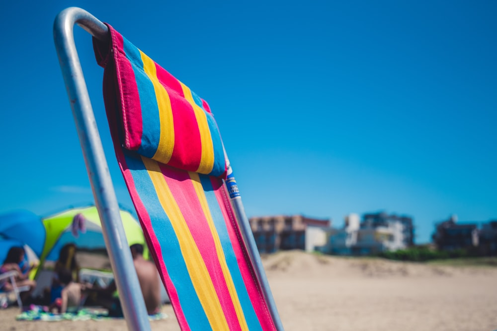 selective focus photography of lounge chair