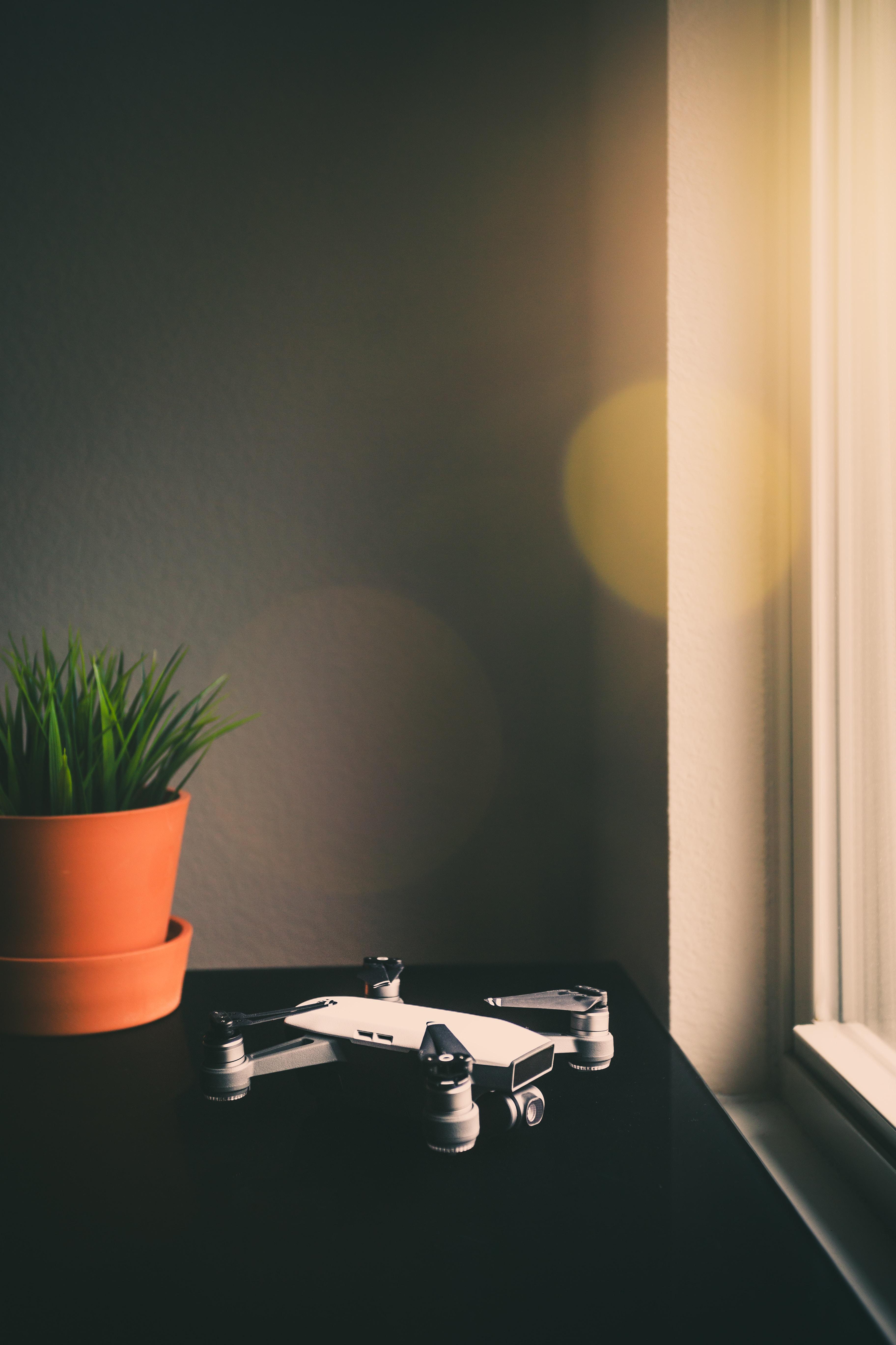 white and black DJI Mavic drone on table