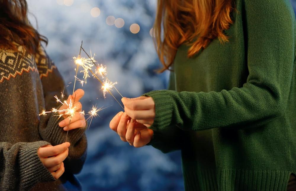 two girls holding firecracker
