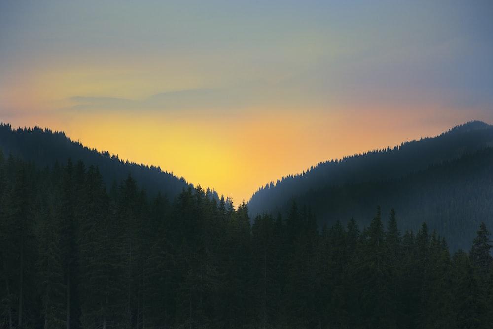 black mountain during sunrise