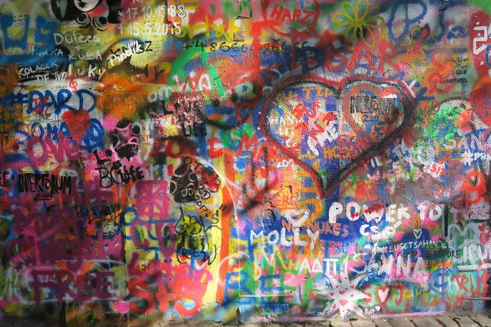 multicolored graffiti on concrete wall