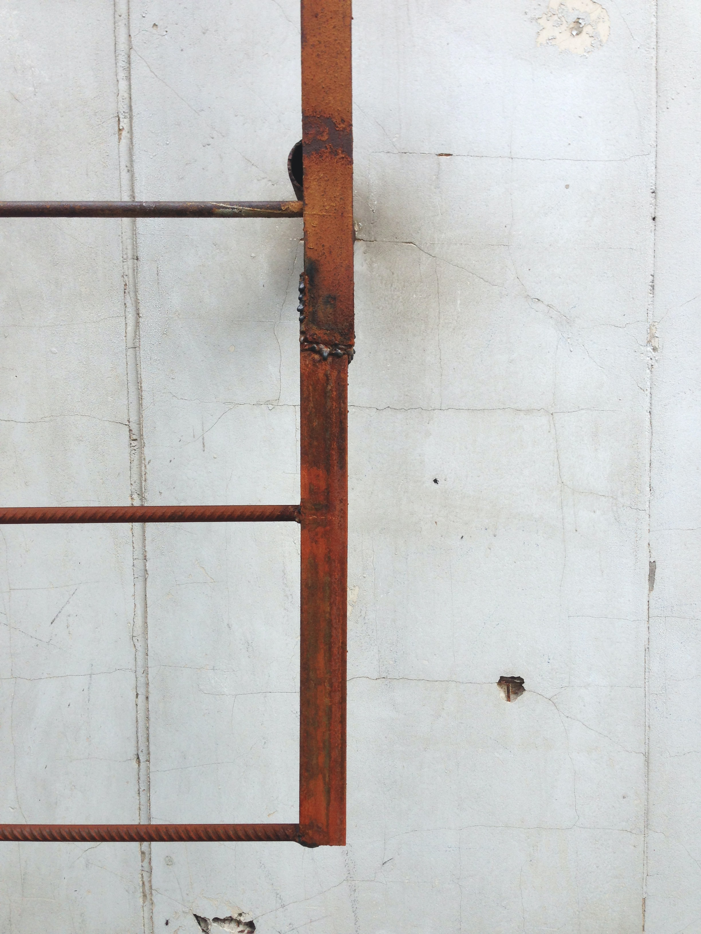 brown metal ladder on wall