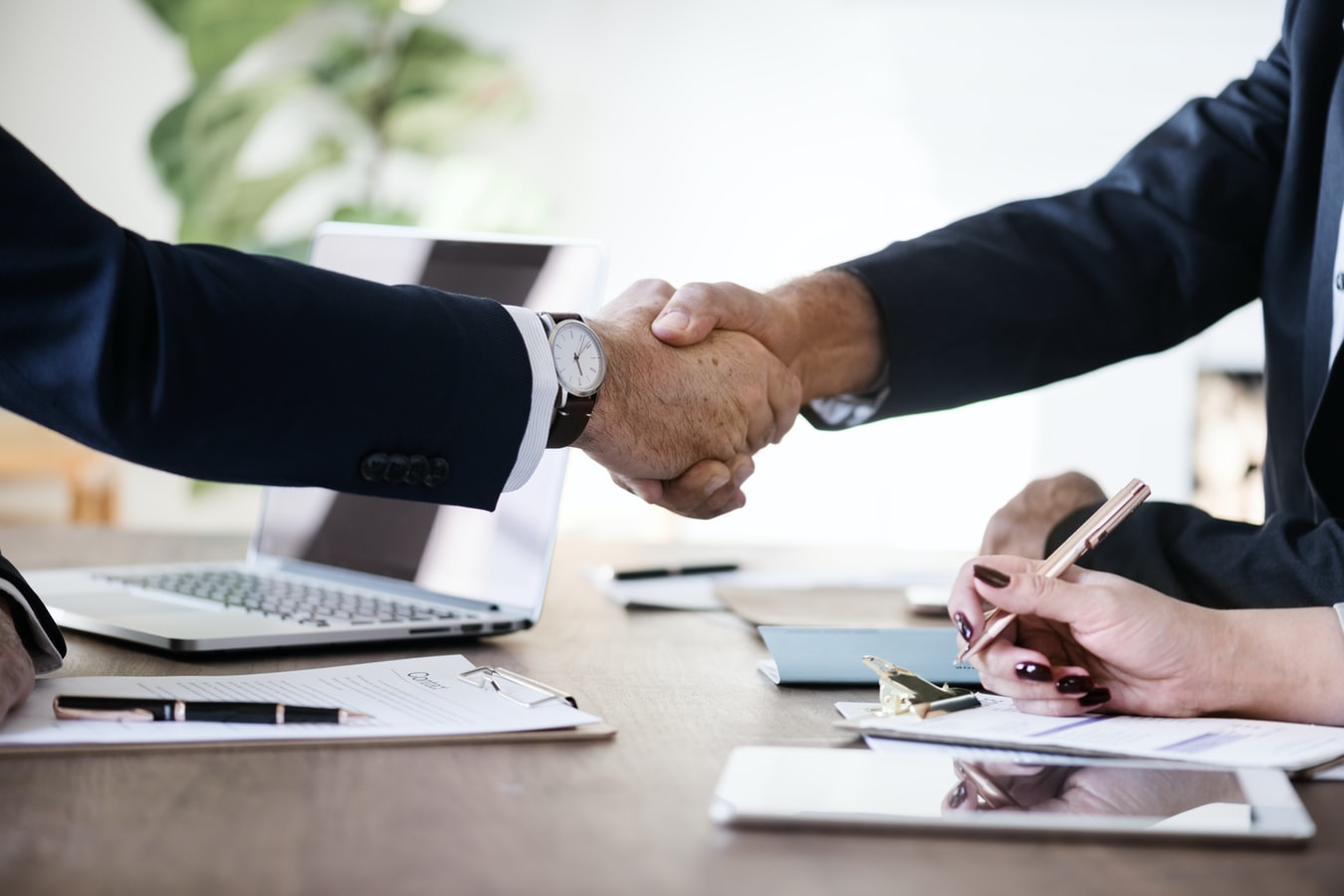 Two men shaking hands during meeting