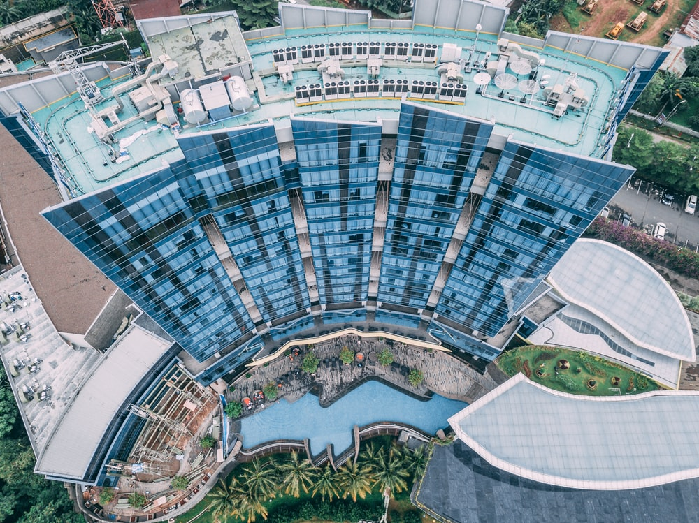fisheye lens aerial photography of blue building
