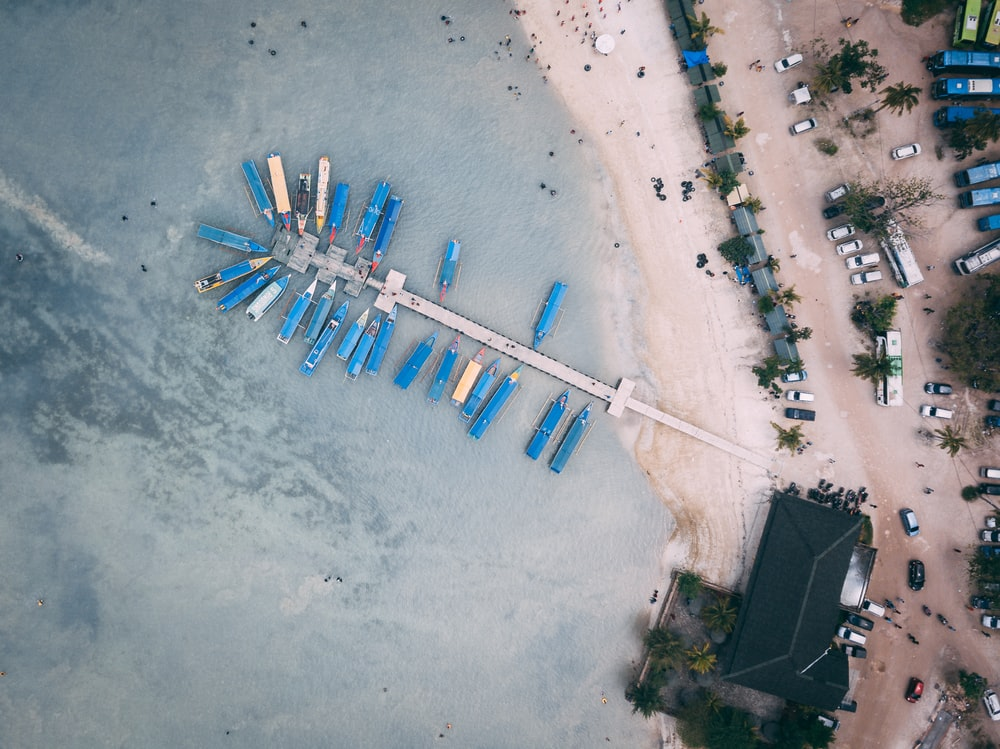 aerial photography of blue boats in sea