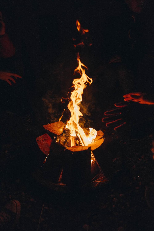 two people near bonfire