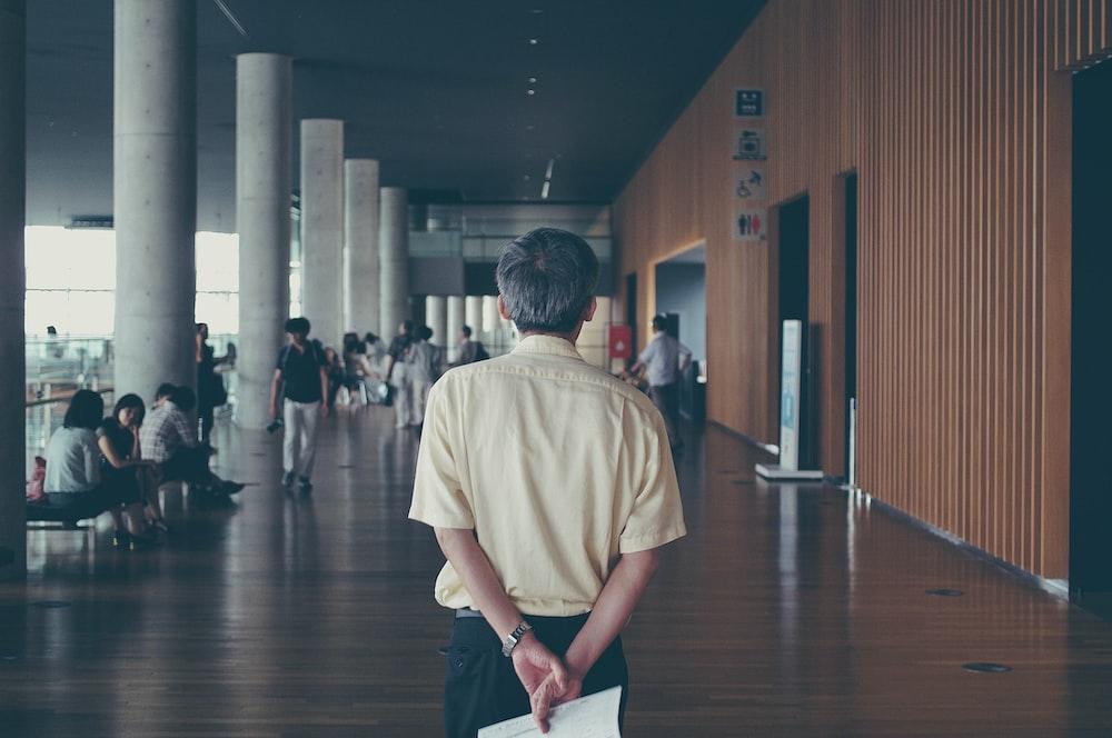 man walking near people