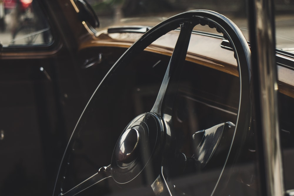 Black Steering Wheel In Selective Focus Photography