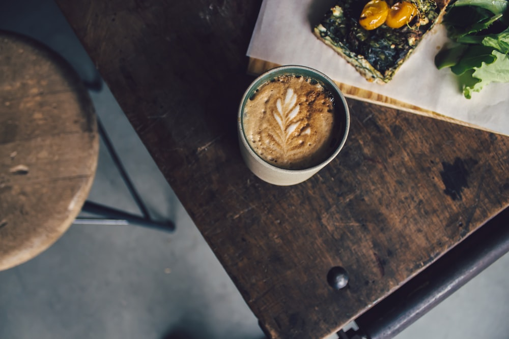 white ceramic mug filled of brown cappuccino