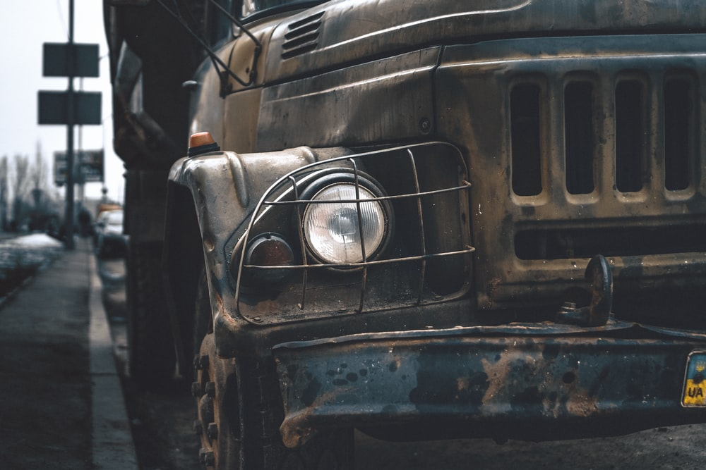 closeup photo of gray vehicle on road
