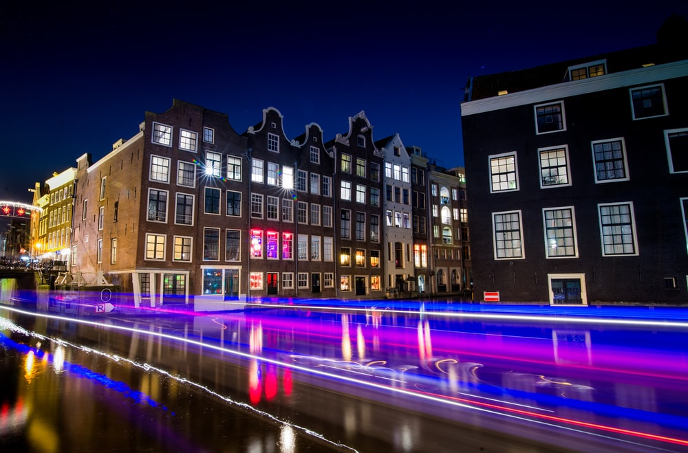 time-lapse photography of busy road and classic establishment