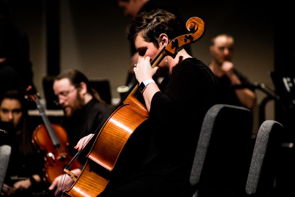 person playing stringed instrument - 5 practice habits for musicians