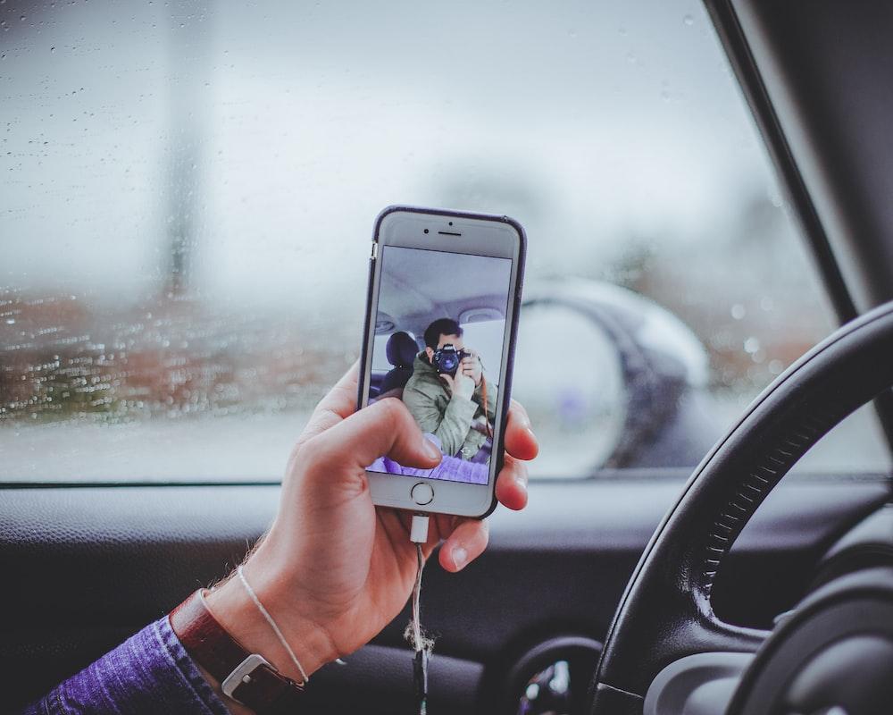 person taking selfie inside the car