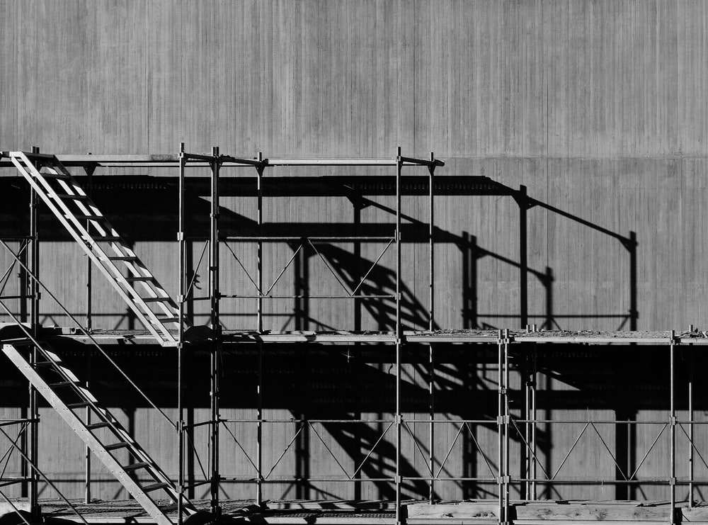 grayscale photography of piled racks