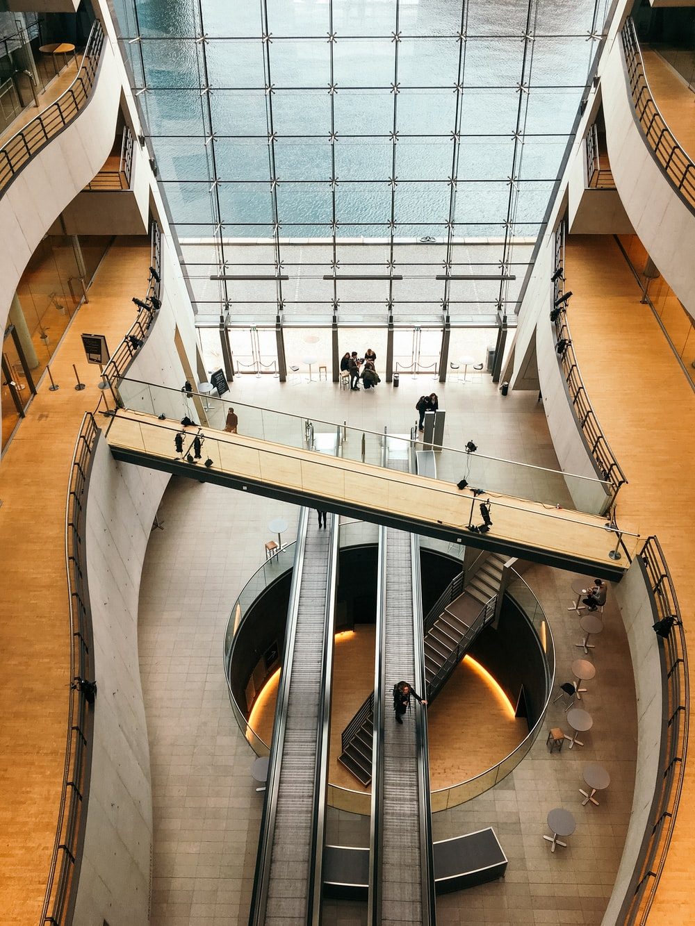 aerial photo of person using escalator indoors
