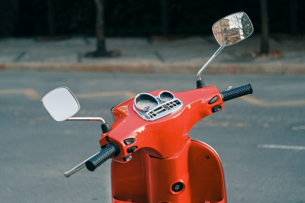 selective focus photography of parked motor scooter