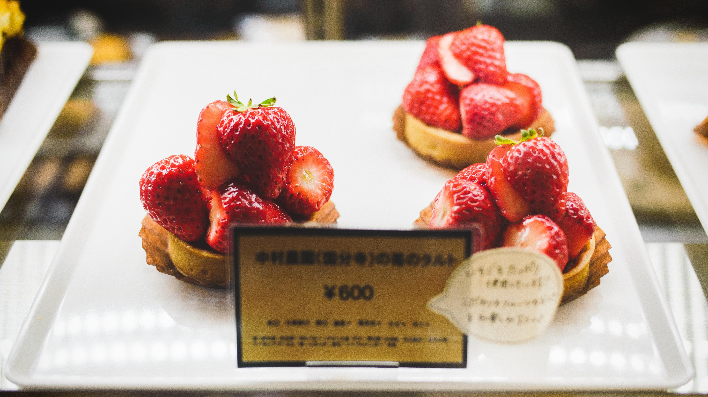 red strawberries on white ceramic tray