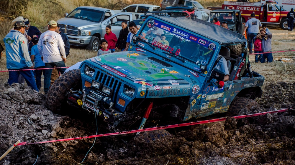 blue Jeep Wrangler on off road track