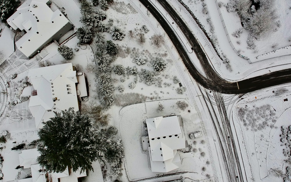 aerial photography of houses coated with snow