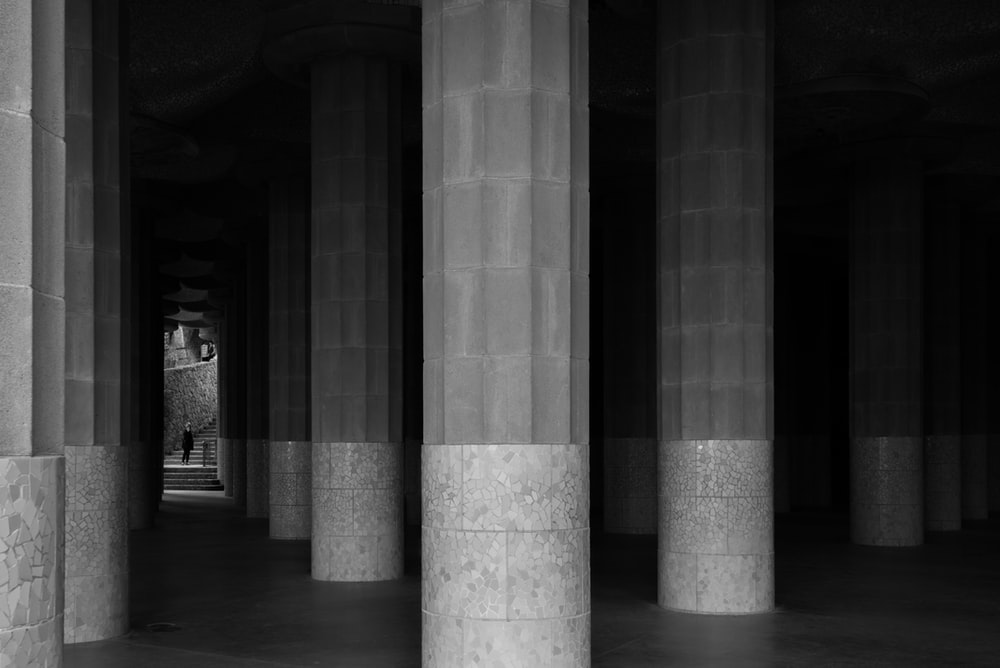 grayscale photo of support pillars
