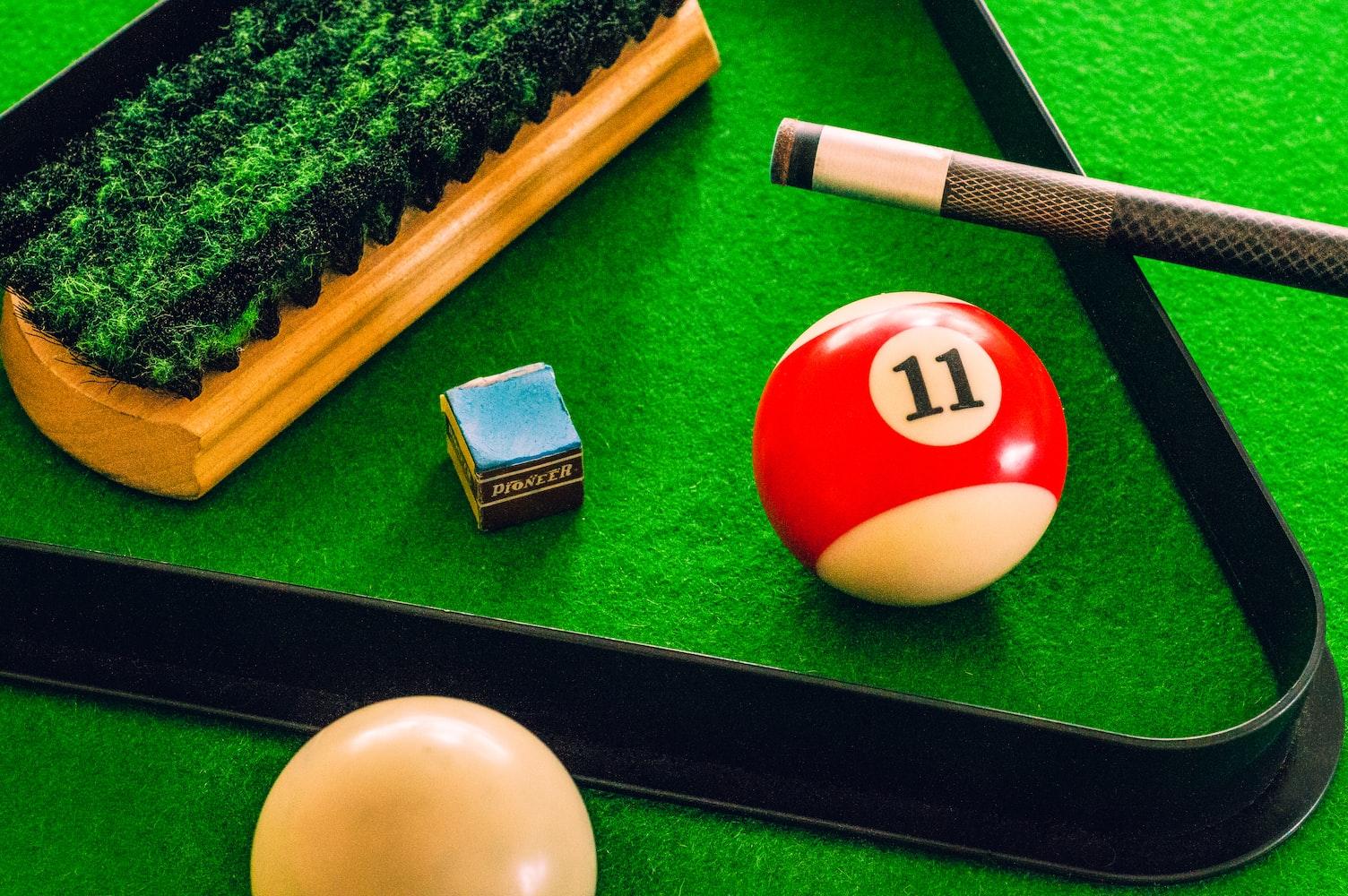 Pool chalk near a billiard balls