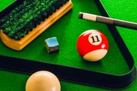 11 cue ball on green surface