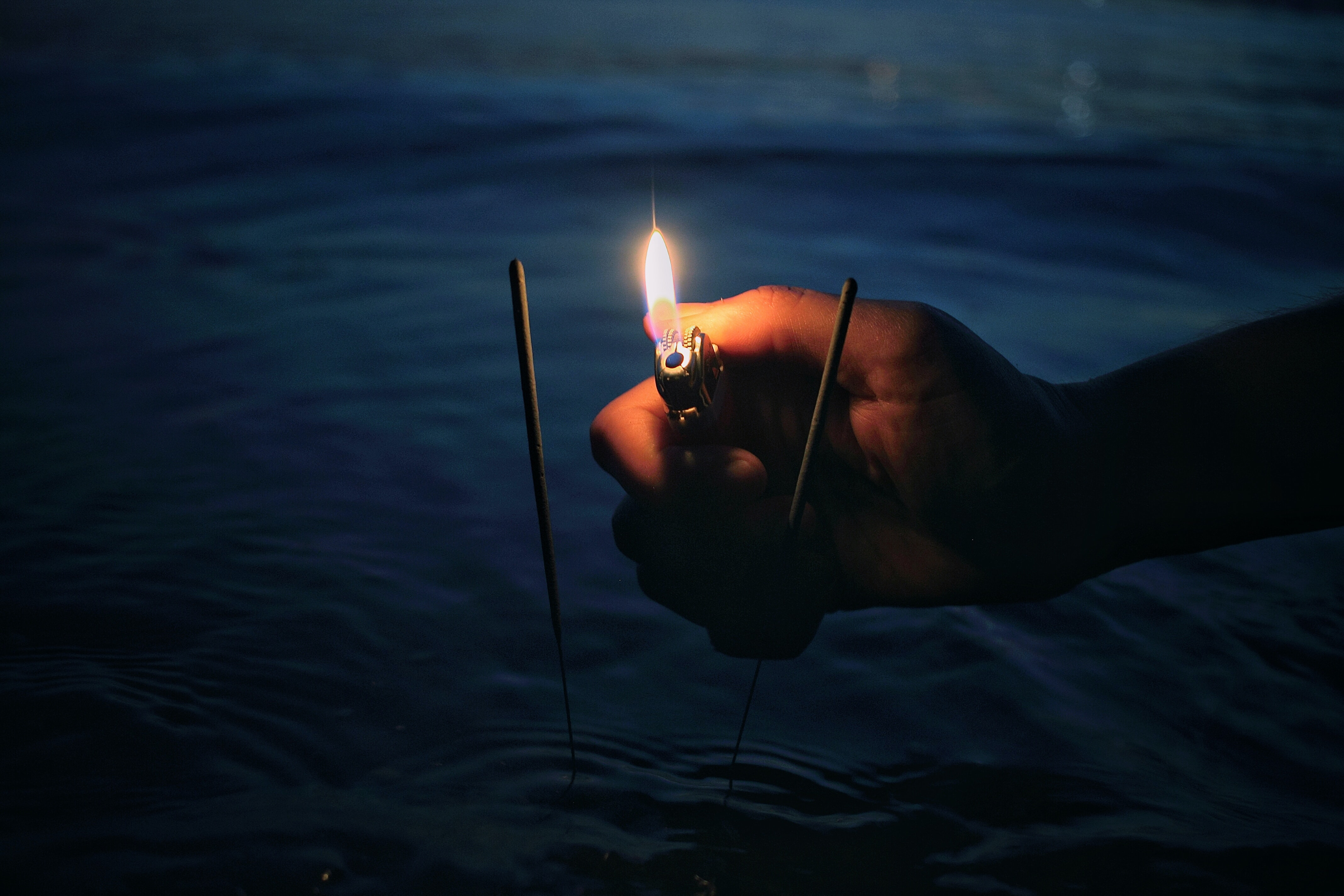 person lighting incense