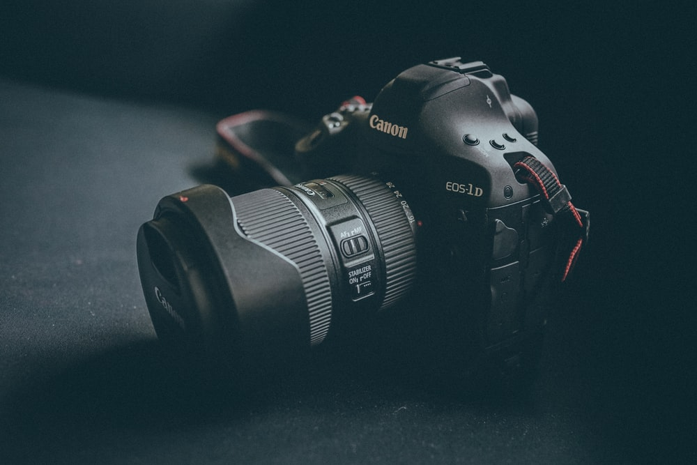 selective focus photography black Canon EOS 1D camera