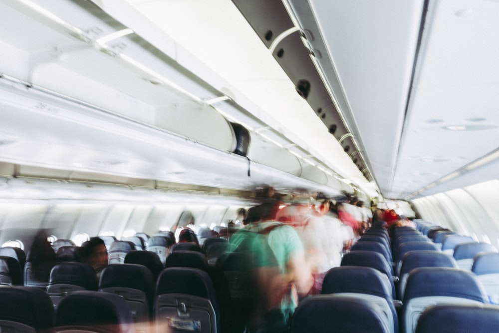 time lapse photography of people walking in airplane hallway