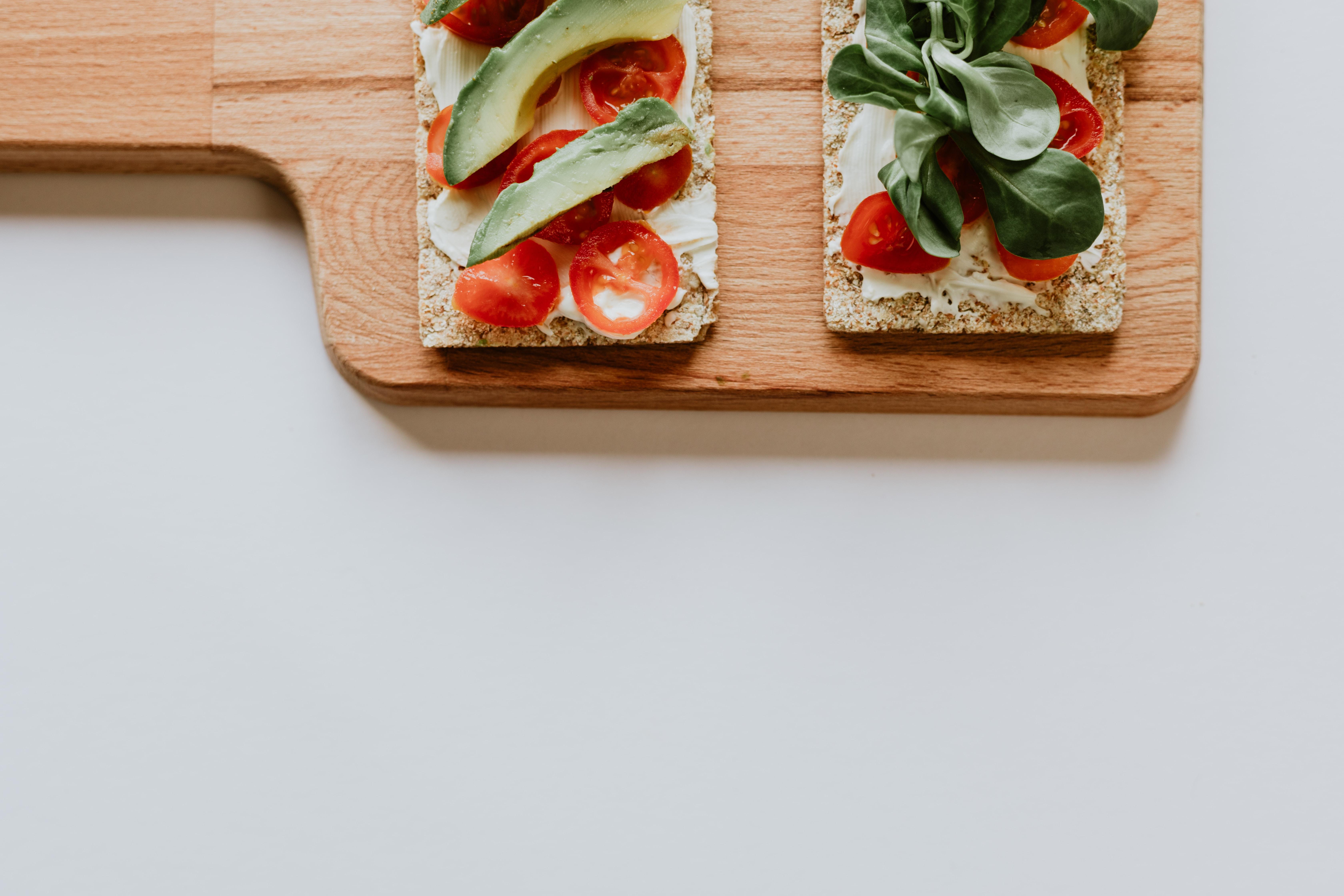 slice avocado and tomatoes on tray