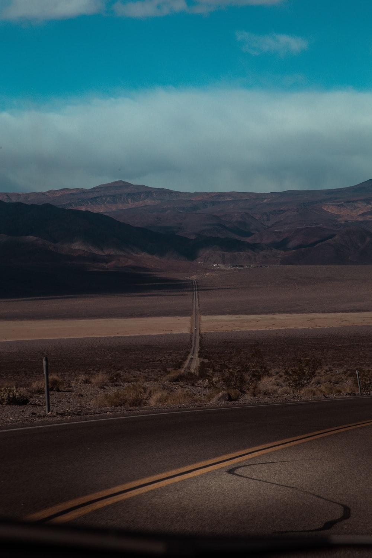 concrete road near hills