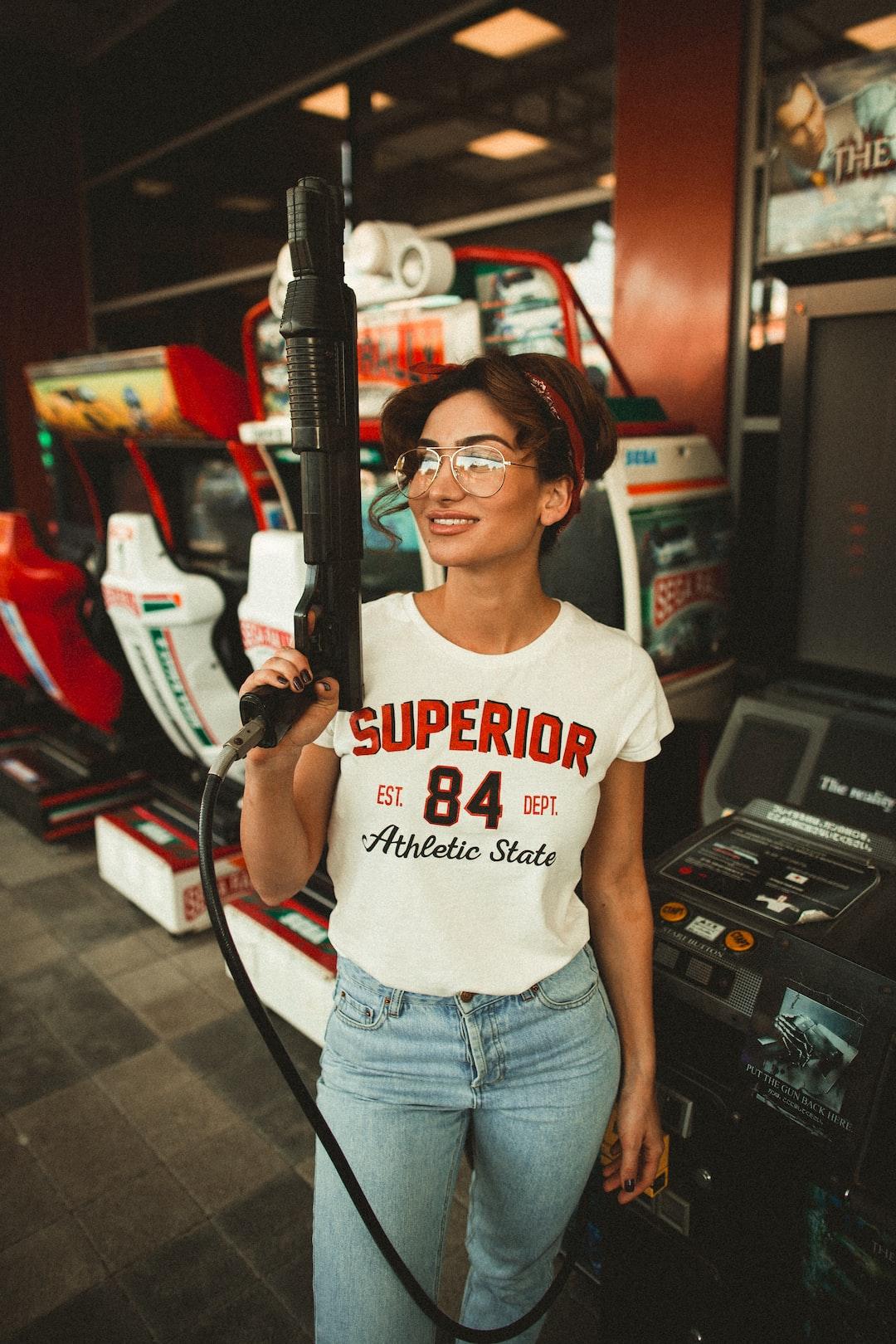 woman holding gun controller