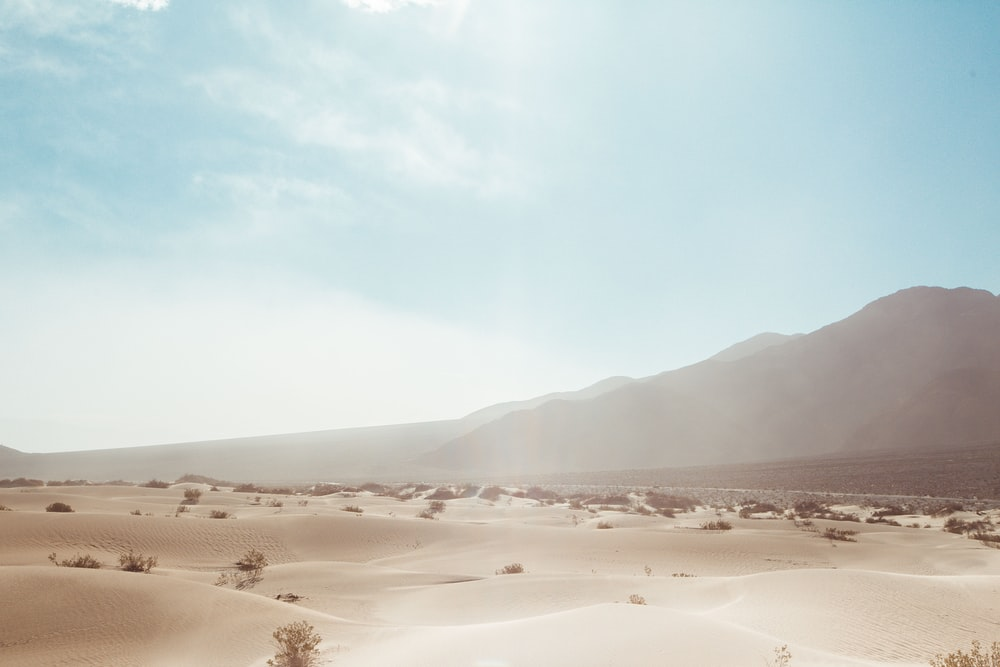 mountain near desert at daytime
