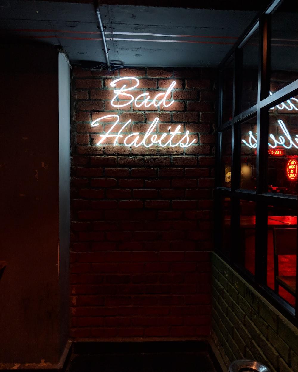 white bad habits LED signage