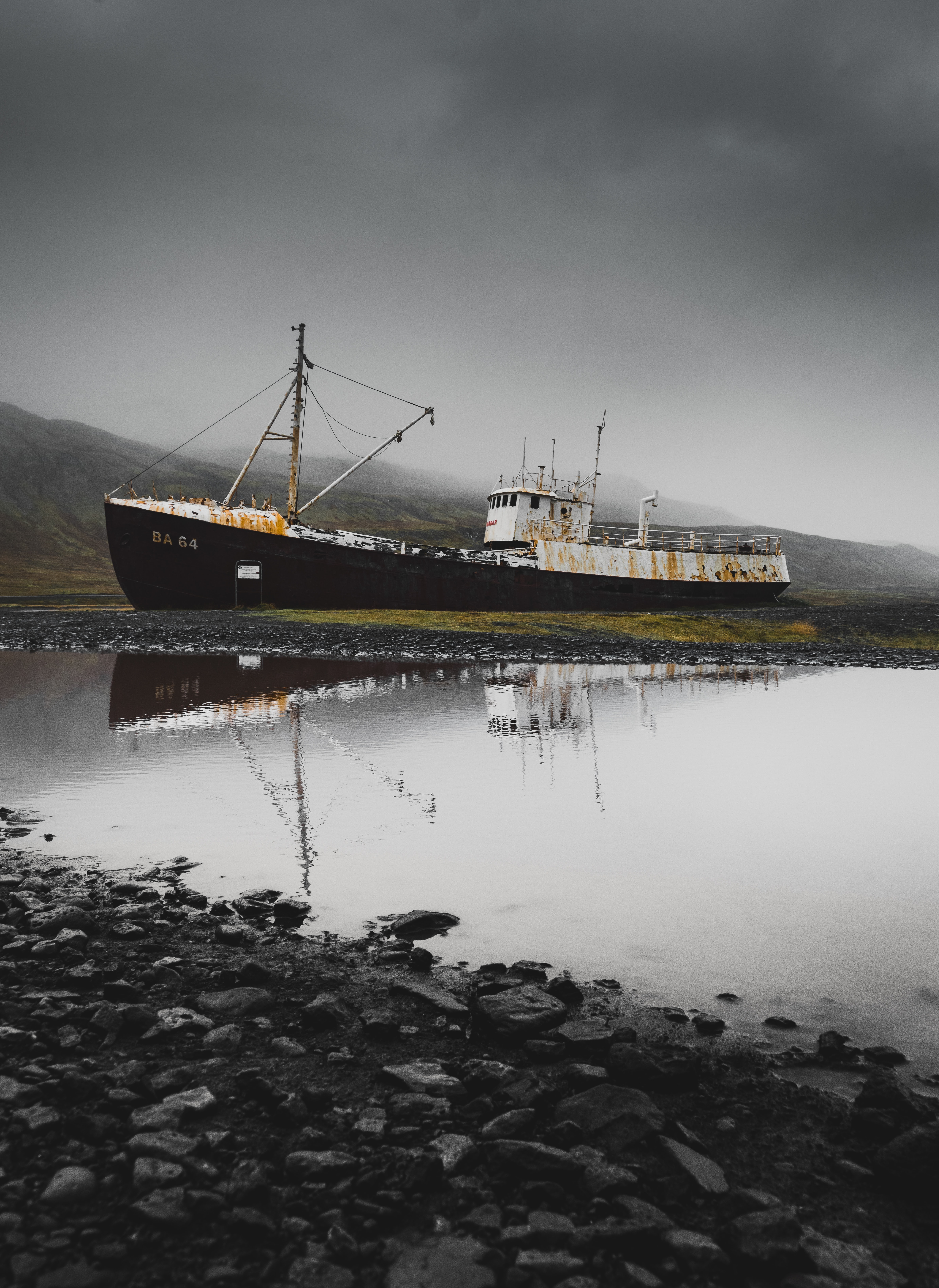 black and white DS 64 cargo ship on field