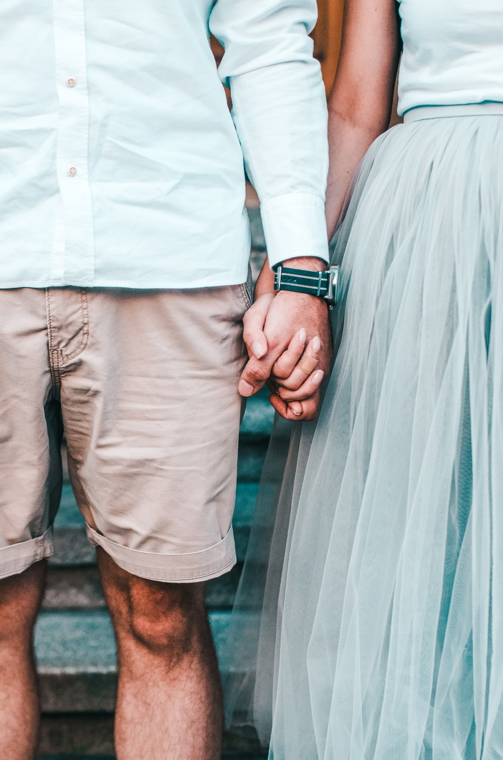 man and woman holding hands while standing