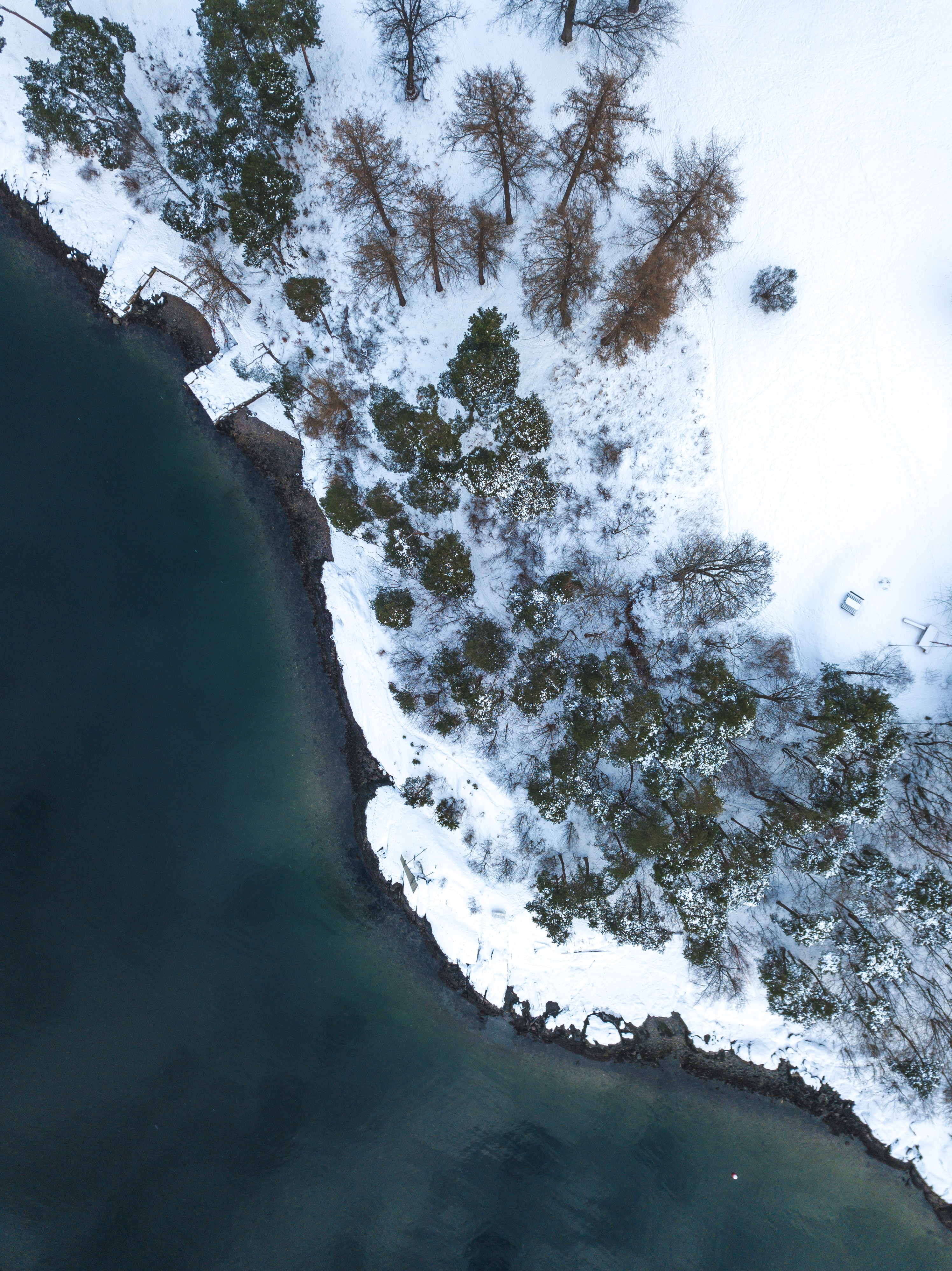 aerial photography of sea near snowy island