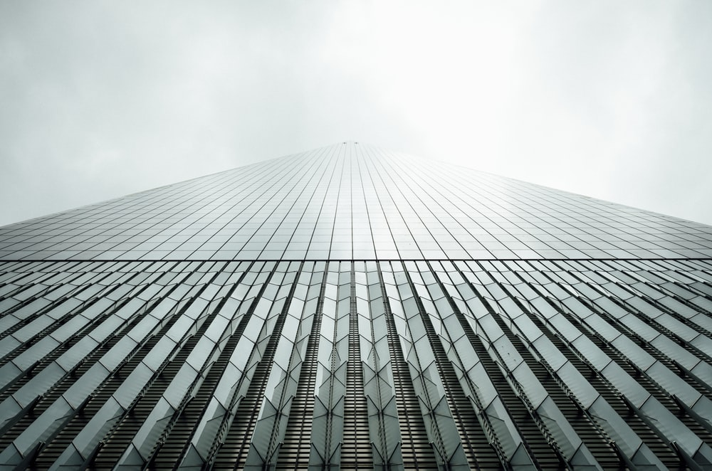 shallow focus photography of curtain wall building at daytime
