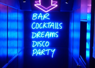 neon sign reading bar cocktails dreams disco party