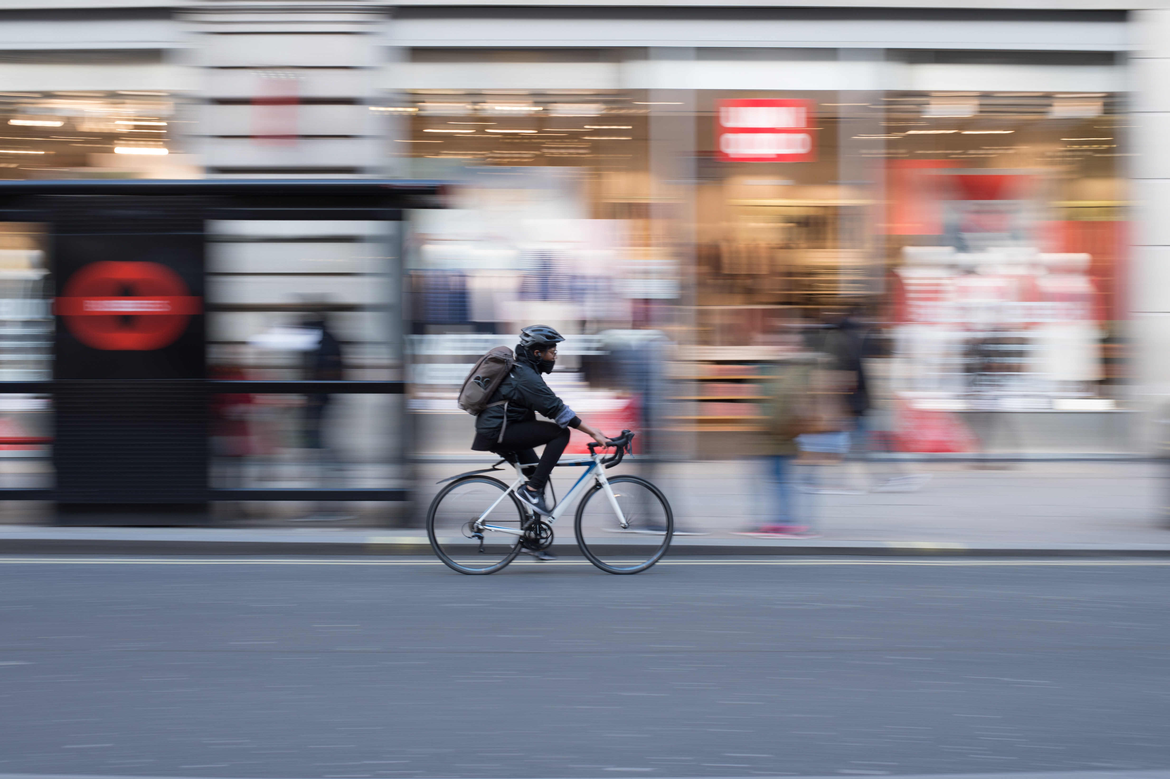 time lapse photo of person riding on white road bicycle