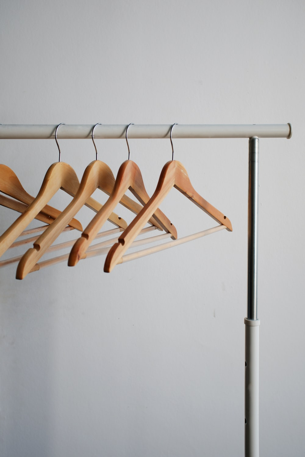 four brown wooden clothes hangers
