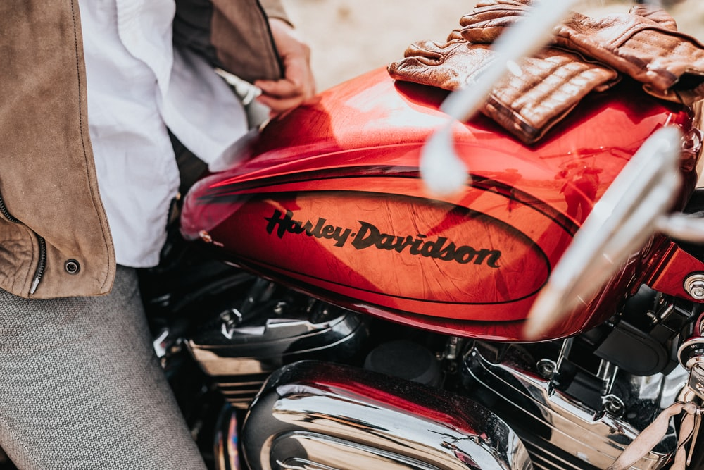 red and black Harley-Davidson motorcycle tank