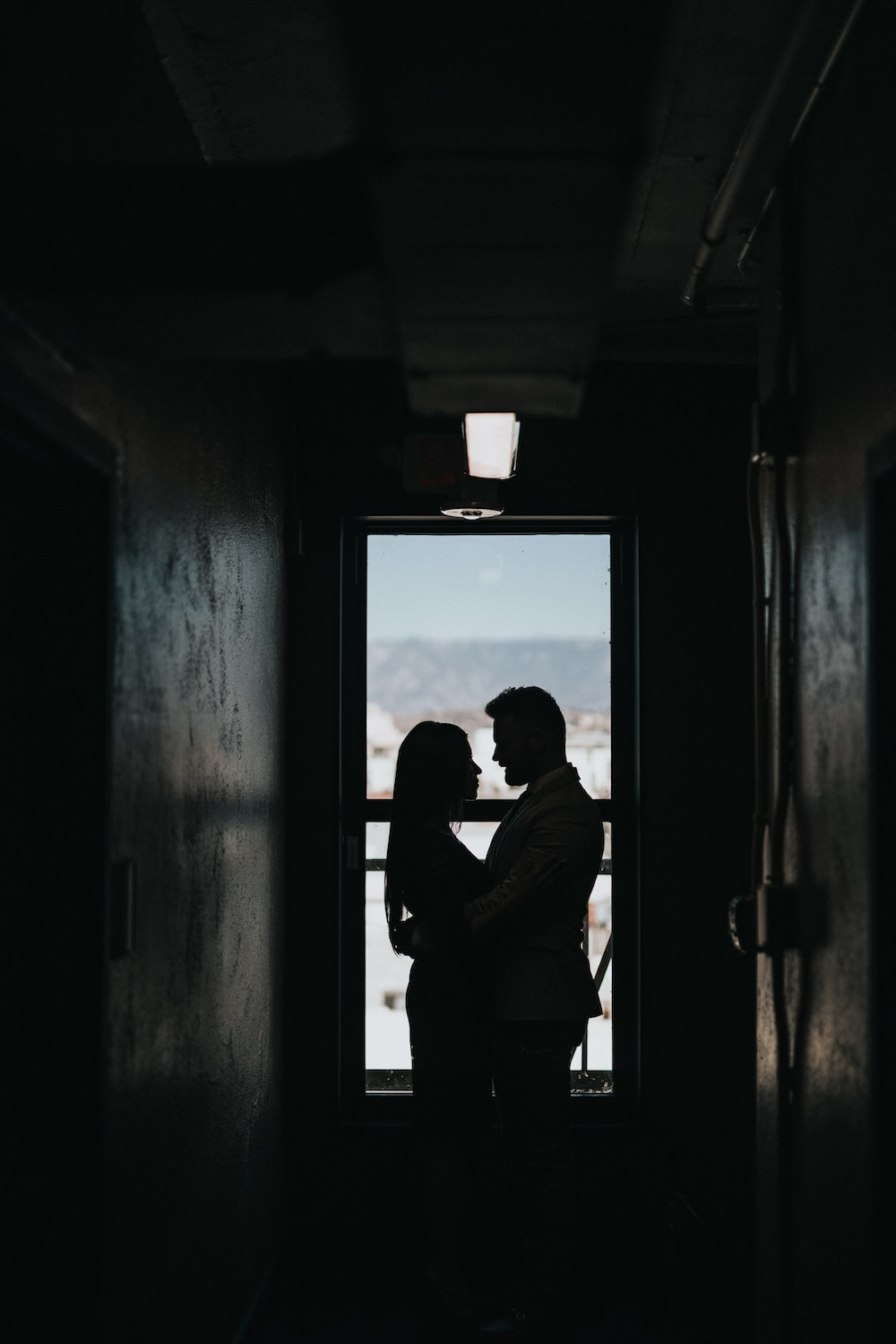 silhouette of couple inside dark room