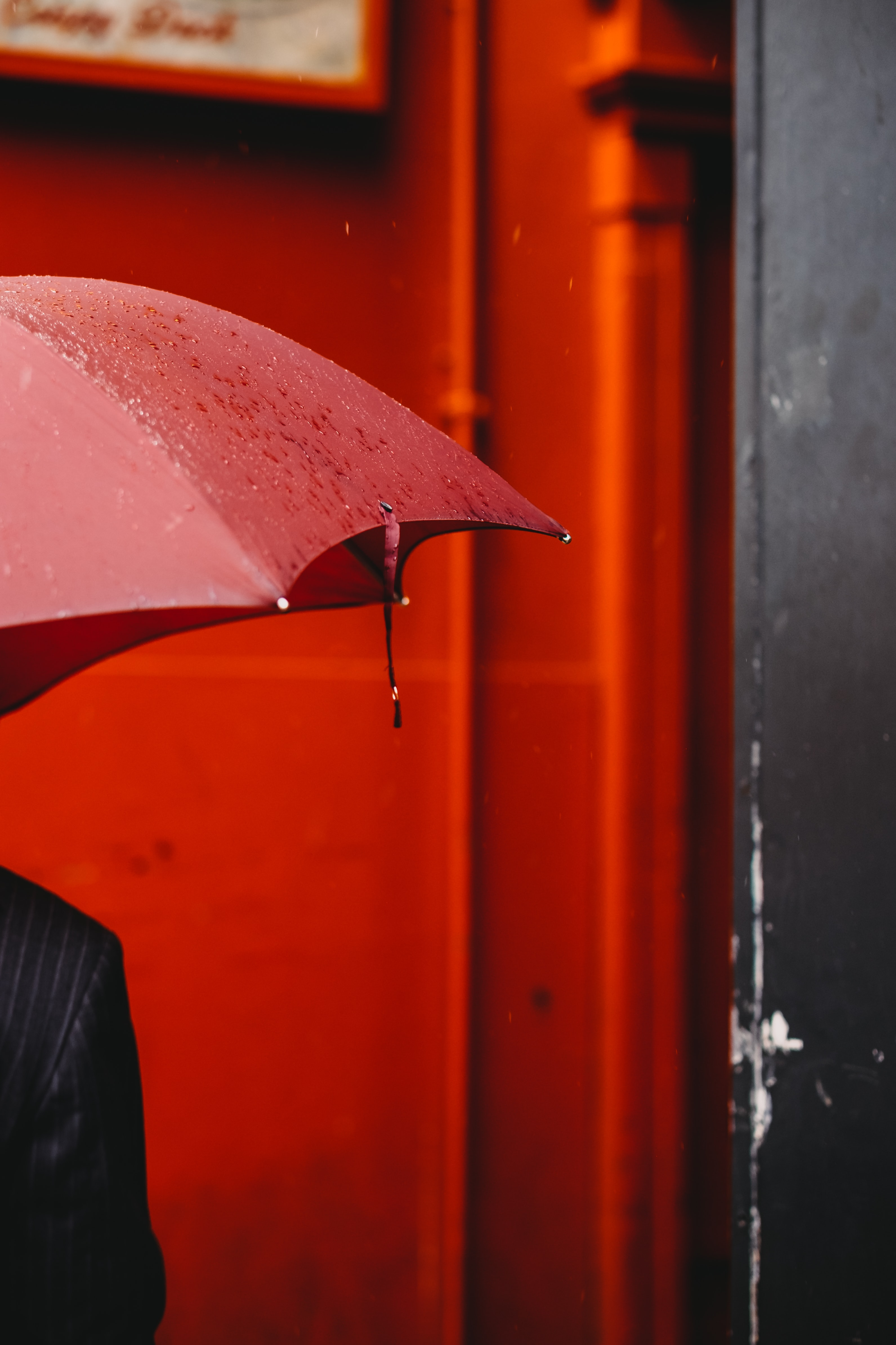 person using red umbrella