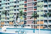 man in black long-sleeved shirt sitting on top of basketball hoop